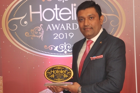 Imran Khan from The St. Regis Mumbai smiles his way to win Front Office Manager of the Year at Hotelier India Awards