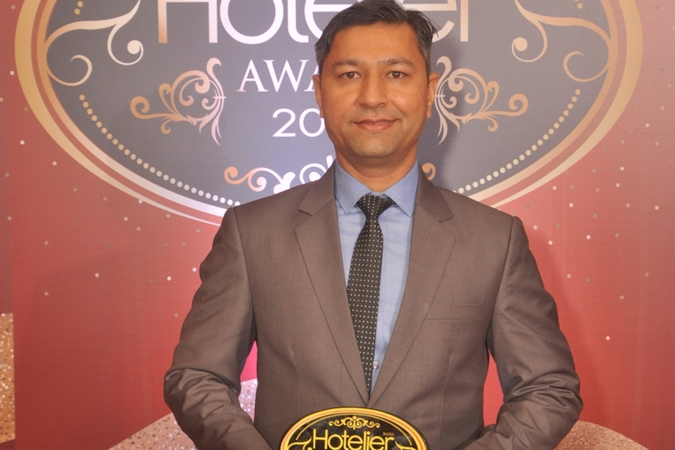 Judged and won, Ramesh Kumar Patel from Jaipur Marriott Hotel receives Hotelier India's Laundry Person of the Year