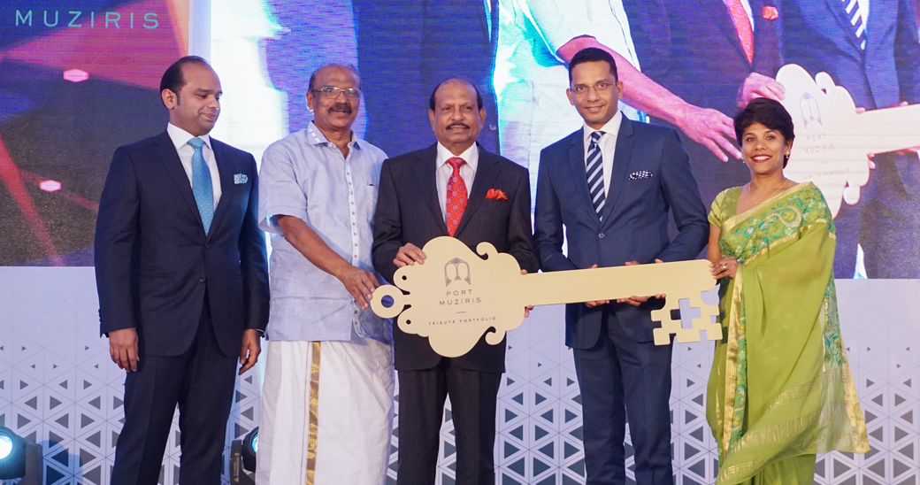 Yusuff Ali MA (chairman, Lulu Group International) handing over the symbolic key of Port Muziris to Harish Gopalakrishnan ( general manager, Port Muziris ) in the presence of Adeeb Ahamed ( managing director of Twenty14 Holdings )