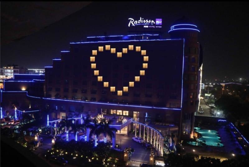Radisson Blu MBD Noida lits up its façade as part of the group's #RadissonCares initiative